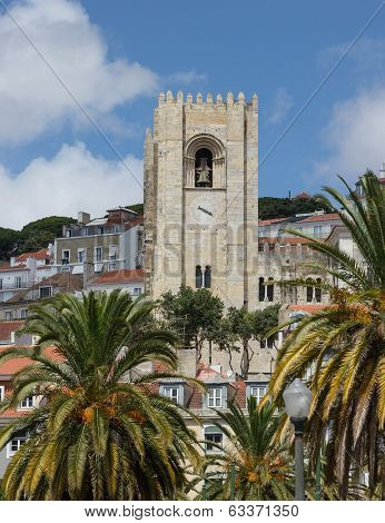 Cathedral belltower against clouds and the sky to Lisbon, Portugal