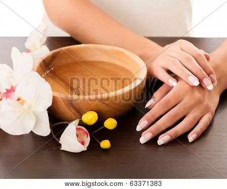 Woman's hands lying on the table