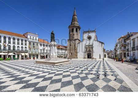 Tomar, Portugal - July 18, 2013: Republica Square in Tomar, with Sao Joao Baptista Church and Gualdim Pais statue (Templar Knight and city founder).