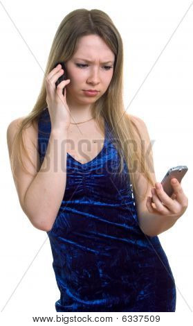Sad Girl In Blue Dress With Two Cellular