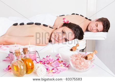 Couple Enjoying A Lastone Massage