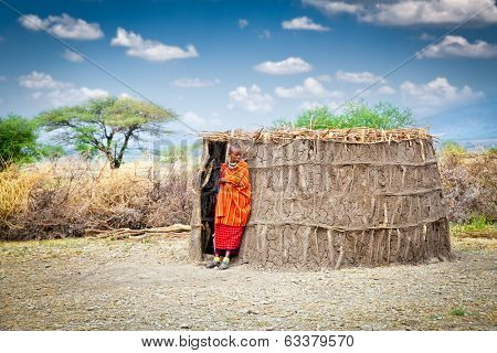 TANZANIA, AFRICA-FEBRUARY 9, 2014: Masai with traditional  hut, review of daily life of local people on February 9, 2014. Tanzania.