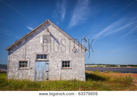 Old building on Atlantic shore in North Rustico, Prince Edward Island, Canada.