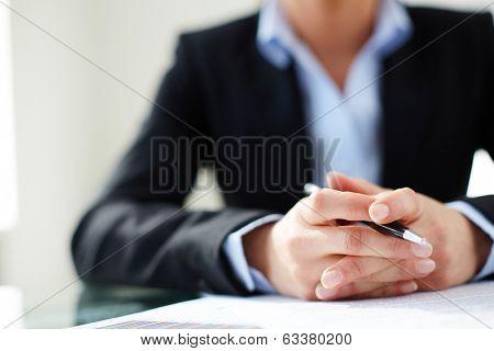 Image of female hands holding pen