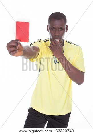 African Referee Showing The Red Card