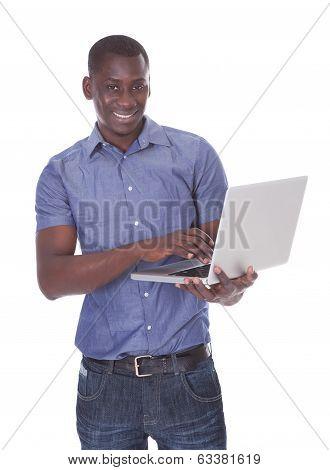 African Man Holding Laptop