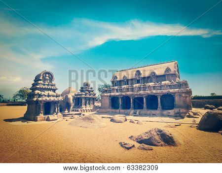 Vintage retro hipster style travel image of Five Rathas - ancient Hindu monolithic Indian rock-cut architecture. Mahabalipuram, Tamil Nadu, South India