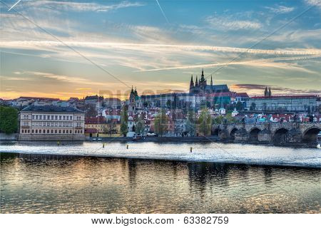 HDR image of view of Charles bridge over Vltava river and Gradchany (Prague Castle) and St. Vitus Cathedral