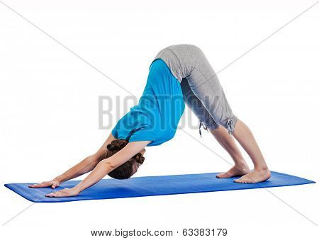 Yoga - young beautiful woman yoga instructor doing Downward Facing Dog (adho mukha svanasana) asana exercise isolated on white background