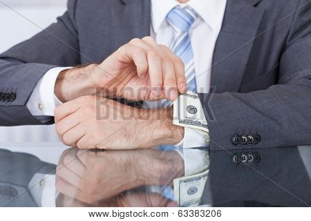 Businessperson Removing Bank Note From Sleeve