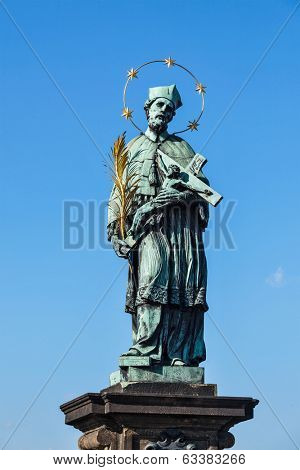 John of Nepomuk (or John Nepomucene) national saint of the Czech Republic statue on Charles Brigde at the site where the saint was thrown into Vltava, Prague