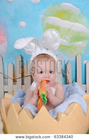 Cute Littl Ebaby Chewing On Easter Carrot Prop