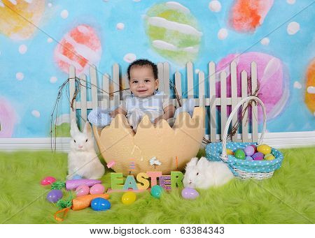 Adorable African Baby Sitting In Giant Easter Egg