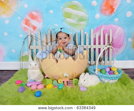 Adorable African Baby Boy Sitting In Giant Easter Egg
