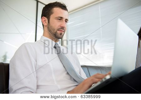 Successful businss man working on computer in modern office