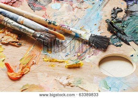 Old Paintbrushes On Used Artistic Pallette