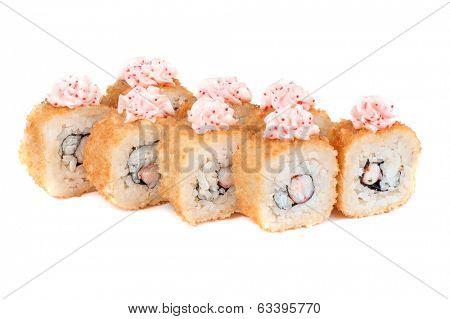 roasted sushi rolls with cucumber, shrimp, tobiko caviar on white
