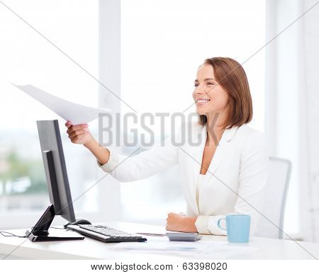 business adn education concept - smiling businesswoman giving papers in office