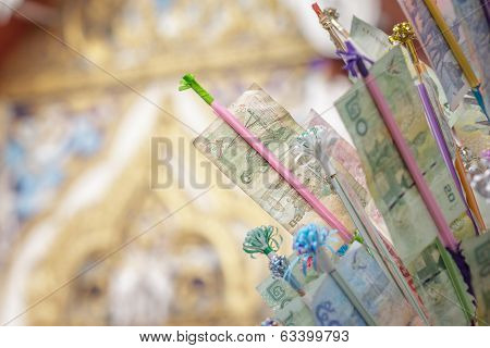Tradition Of Buddhist Festival; Banknotes With A Decorative Timber For Donations.