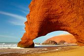 foto of atlantic ocean  - Red archs on atlantic ocean coast - JPG
