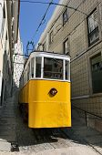 pic of tram  - Old yellow tram standing in the street of Lisbon - JPG