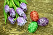 beautiful scratched handmade Easter eggs and tulip flowers