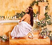 Woman relaxing at flower water spa.