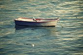 Small wooden boat at the beach of La Caleta, Cadiz, Andalucia, Spain