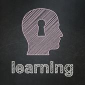 Education concept: Head With Keyhole and Learning on chalkboard background