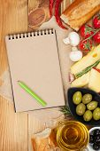 Blank notepad for copy space and various food