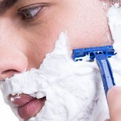 image of razor  - young man shaving the  beard with the razor  - JPG