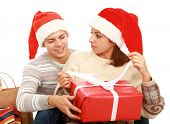 couple in Santa hats with presents isolated on white background