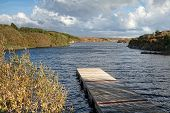 Wooden Pier On Irish River