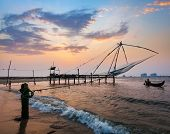 stock photo of fishnet  - Kochi chinese fishnets on sunset - JPG