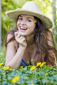 Attractive Woman In Hat And Flowers