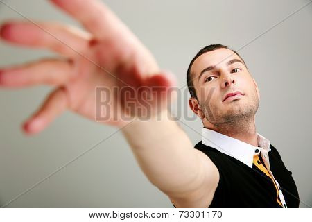 Portrait of a man reaching for something