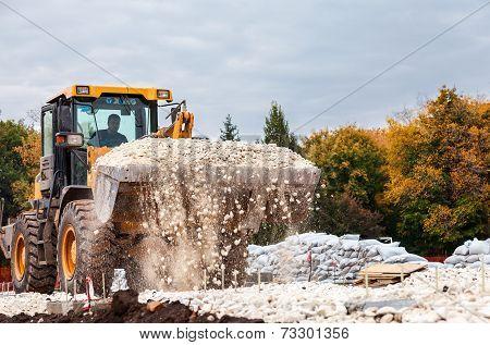 Samara, Russia - September 28, 2014: Heavy Bulldozer Loading And Moving Gravel On Road Construction