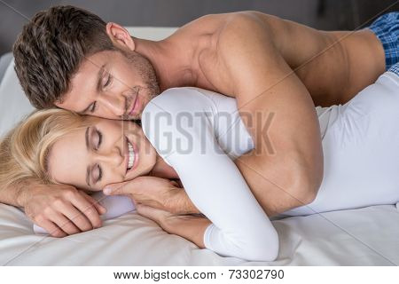 Close up Smiling Middle Age Caucasian Lovers Lying in White Bed So Sweet