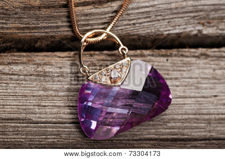Elegant jewelry on wooden background