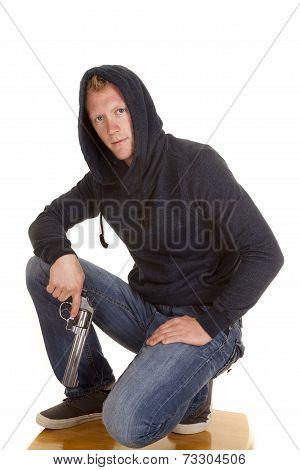 Man In Dark Hoodie Hold Gun Looking