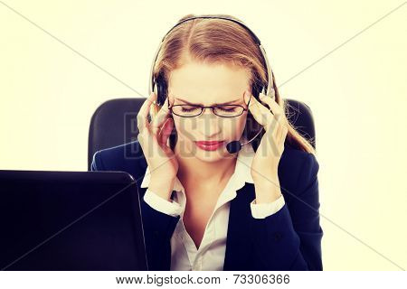 Tired business woman at call center sitting by the table or it is a failure. Isolated on white.