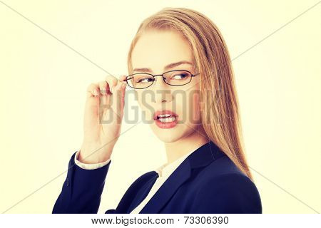 Beautiful caucasian business woman in eyeglasses is looking aside. Isolated on white.