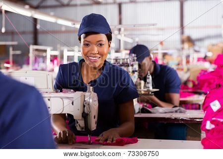 portrait of african machinist sewing