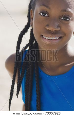 African girl with orthodontic braces