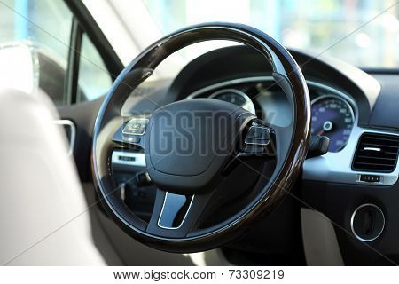 Interior view of car with beige salon and black dashboard