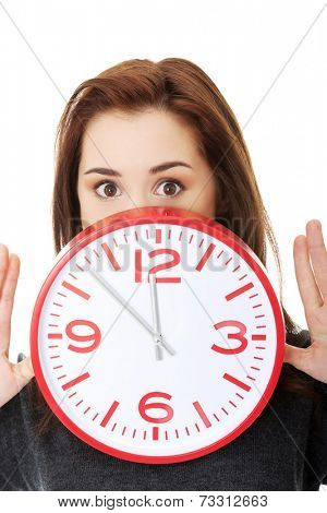 Young woman with clock. Time concept.