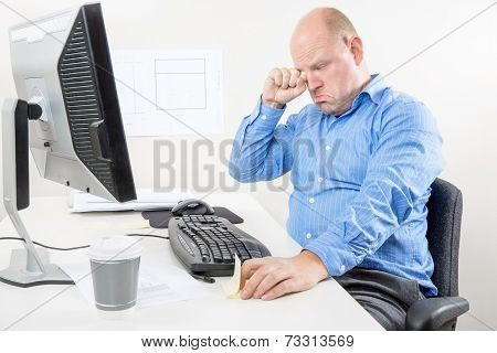 Businessman crying and whining at the office