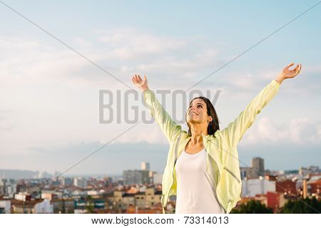 Happy Female Athlete On Outdoor Training Raising Arms