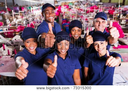 group of happy clothing factory co-workers thumbs up
