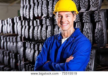 handsome gumboots factory worker with arms folded